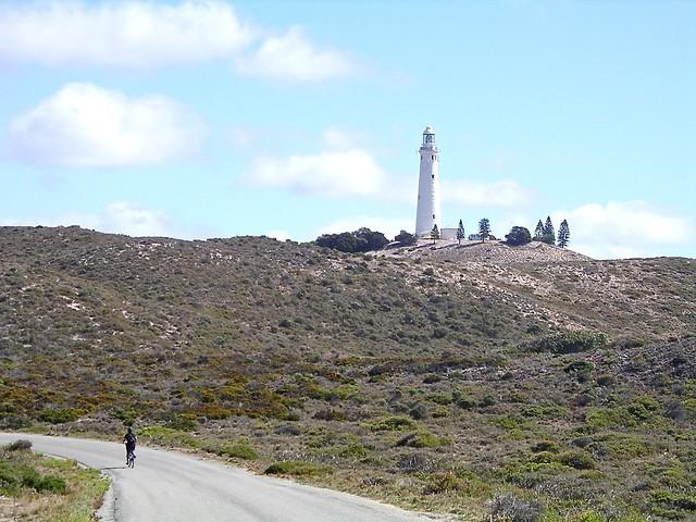 Jill riding past Rotto main lighthouse, 18 April 2007