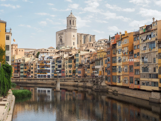 Cathedral and colorful buildings in Girona on the banks of the Onyar river