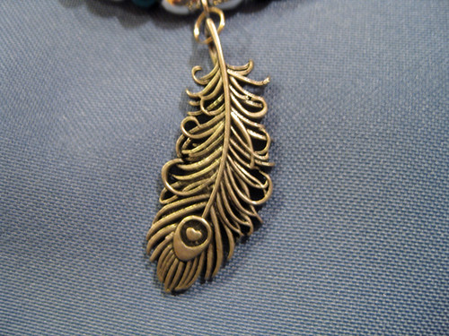 store pendant necklace feather peacock met the