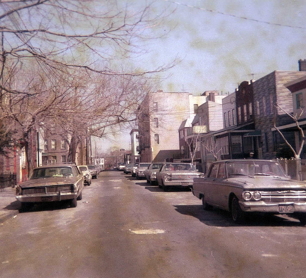 McKinley Street in Brooklyn with lots of battered 1960s ca ...