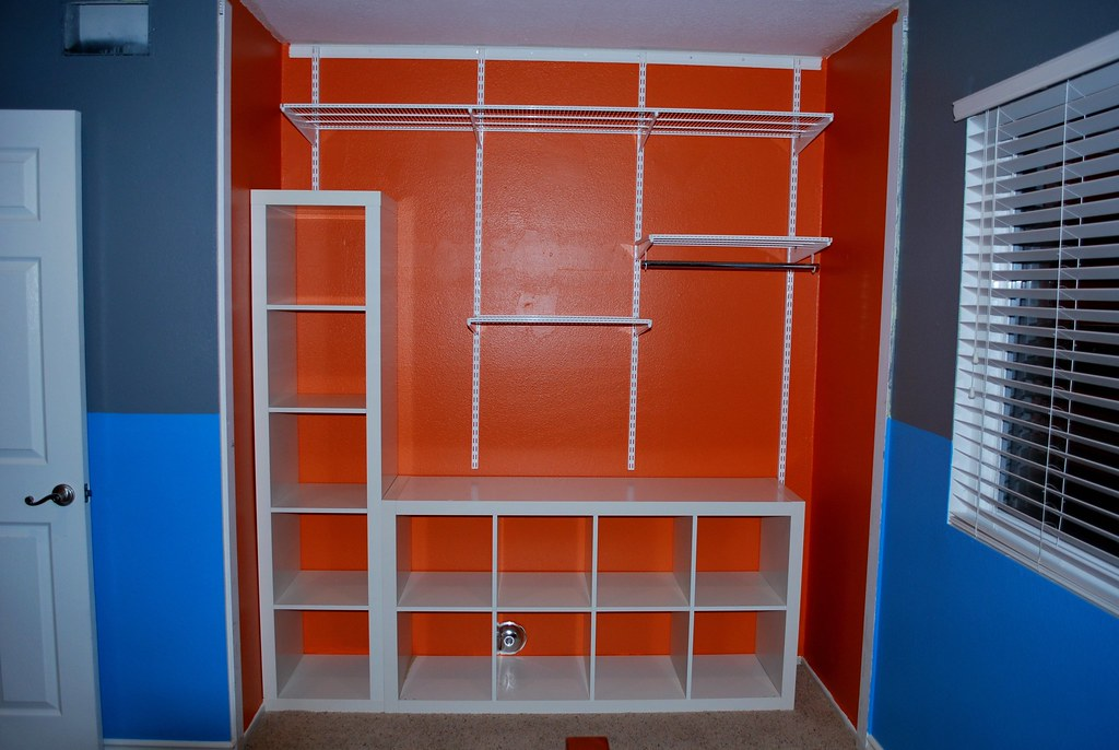 Orange closet with ikea expedit and container store elfa s for Ikea expedit closet