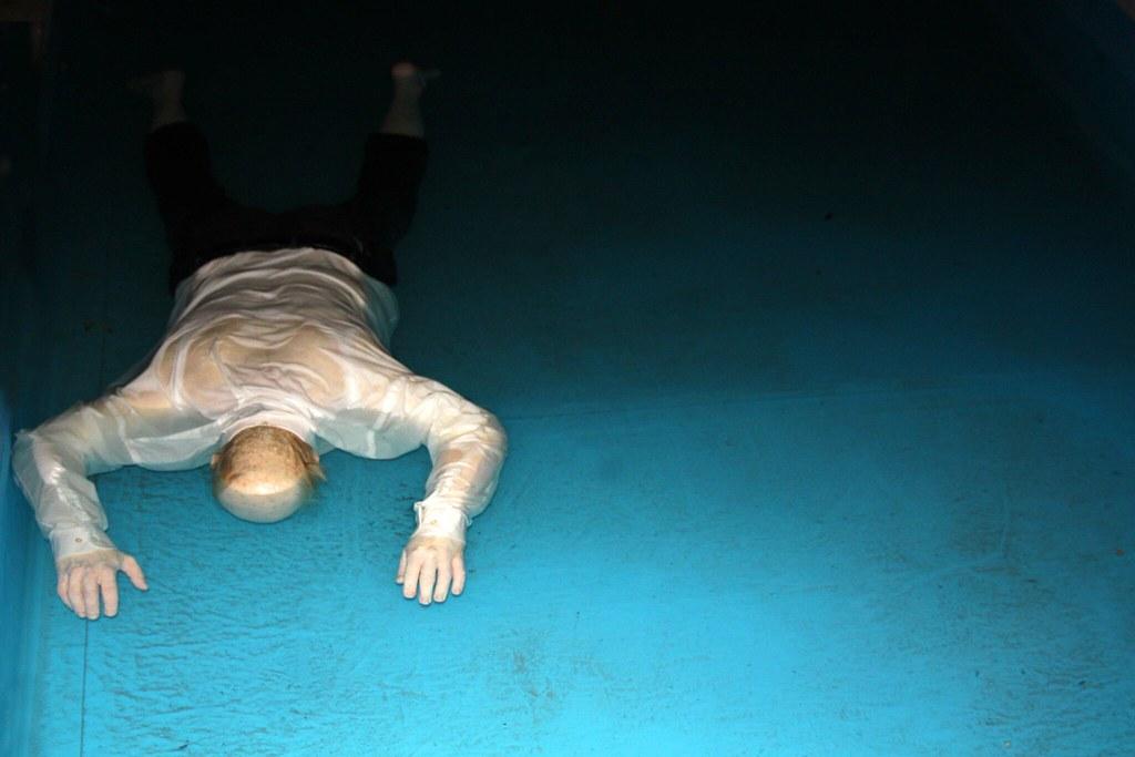 Swimming Pool Abuse : Dead man into a swimming pool biennale di venezia