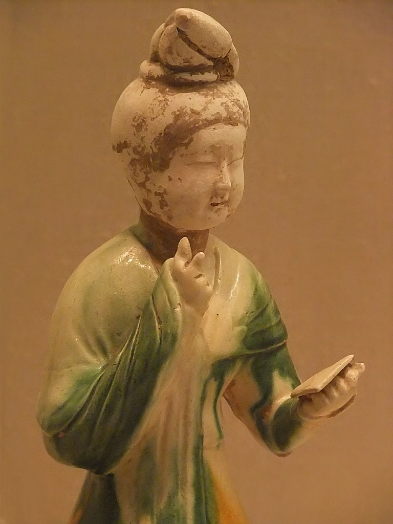 Tomb figure of Seated Woman holding a mirror Tang Dynasty ...