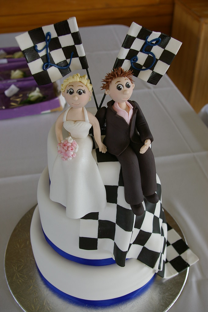 bride and groom wedding cakes racing wedding cake with fondant and groom wedding 2071