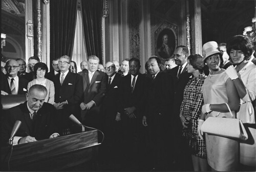 Photograph of President Lyndon Johnson Signs the Voting Rights Act as Martin Luther King, Jr., with Other Civil Rights Leaders in the Capitol Rotunda, Washington, DC, 08/06/1965 | by The U.S. National Archives