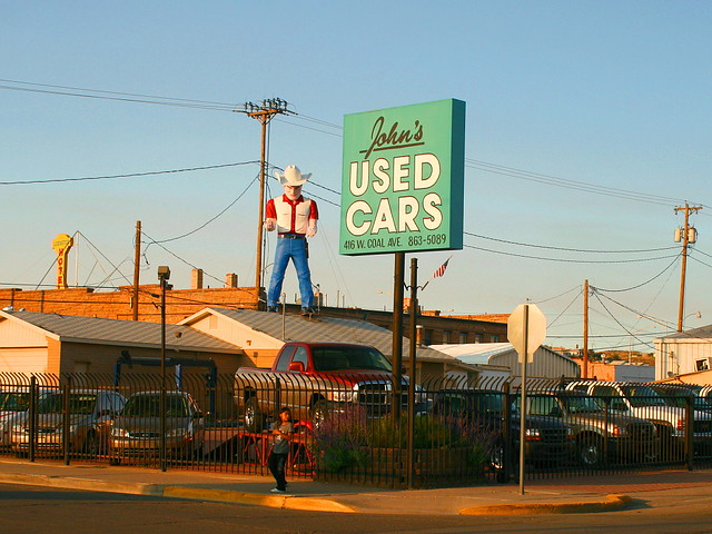 Certified Pre Owned >> Cowboy Muffler Man | It's refreshing to see John's Used Cars… | Flickr