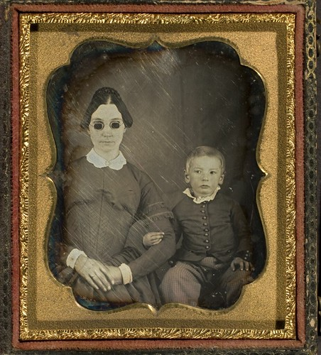 Portrait of blind woman (wearing dark glasses) and child | by George Eastman Museum