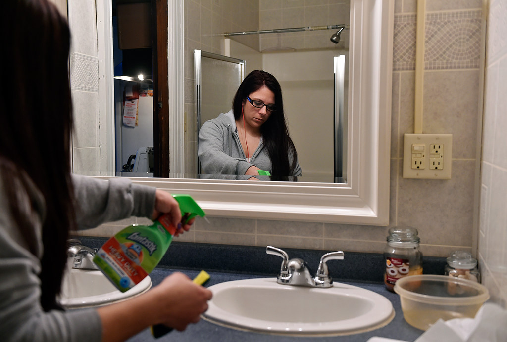 © 2016 by The York Daily Record/Sunday News. Kailyn Brown, 24, of York Township, cleans the downstairs bathroom of a Pennsylvania Avenue home operated by Choices Recovery House on Wednesday, Feb. 3, 2016.