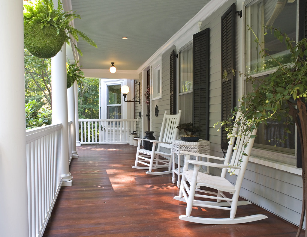 Porch | Stone pillars, picket fences introduce this C ...