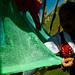 A green Tibetan prayer flag.