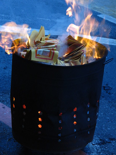 Burning Paper Money | by eazytraveler