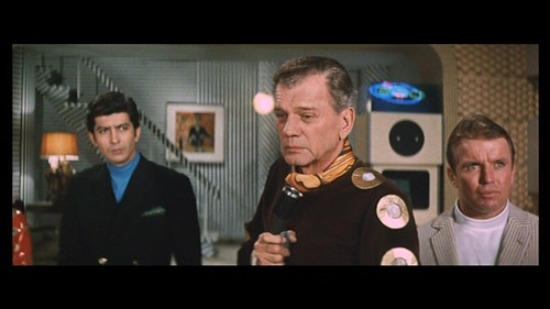Joseph Cotten (center) as Capt. McKenzie, with Masumi Okada (left) and Richard Jaeckel (right) in LATITUDE ZERO