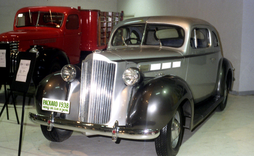 1938 Packard Sedan And Chevrolet Truck On Display In The S
