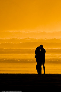 Lovers embracing on the beach at sundown / sunset on Morro Strand State Beach 10 Jan 2010 | by mikebaird
