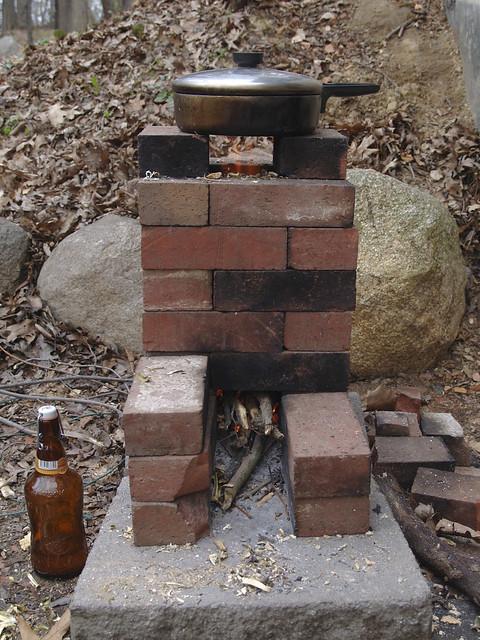 Scrap brick rocket stove flickr photo sharing for Rocket stove inside fireplace