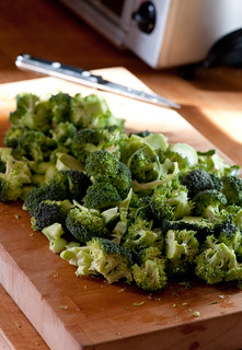 raw brocoli on wooden chopping board | by jules:stonesoup