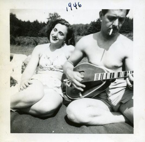 1946 shirtless man in swim trunks smoking with mandolin woman outdoors swimsuit vintage photo | by Christian Montone