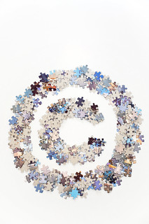 Copyright sign made of jigsaw puzzle pieces separated | by Horia Varlan