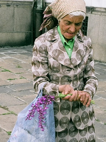 An elderly woman selling flowers | by World Bank Photo Collection