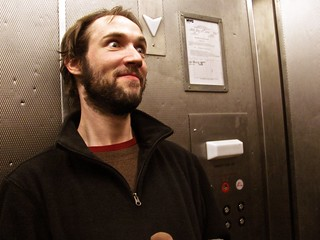 Ian Corey in the hundred-year-old elevator at Nuthouse Hardware | by Jeffrey