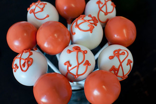orange and white anchor pops | by Sweet Lauren Cakes