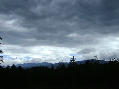 Thick rain clouds covering bright blue skies / Las nubes de lluvia cubren el cielo de azul brillante | by Trevor.Huxham