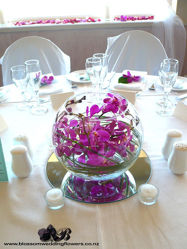 Pink orchid bowl centrepiece wedding reception table