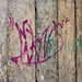 Pink graffiti and turquoise writings on concrete blocks