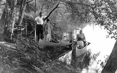 Two couples with canoes boating in Lake Washington, University of Washington | by UW Digital Collections