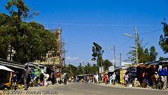 Shoppers and merchants line the side of the road in a market area of Addis Ababa, Ethiopia.. | by Rowan Gillson