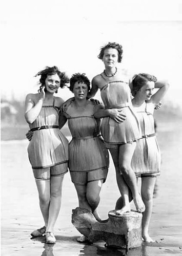 """Spruce Girls"" on beach wearing spruce wood veneer bathing suits during ""Wood Week"" to promote products of the Gray Harbor lumber industry, Hoquiam, Washington 