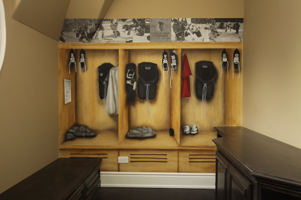 hockey locker room back wall a mural that was done in a