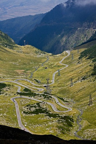 Road with hairpin turns through mountain valley | by Horia Varlan