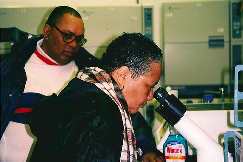Deborah Looking at Her Mother's Cells Through a Microscope for the First time, 2001 | by RebeccaSkloot