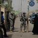 Deleware Guardsmen provide security while school gets aid
