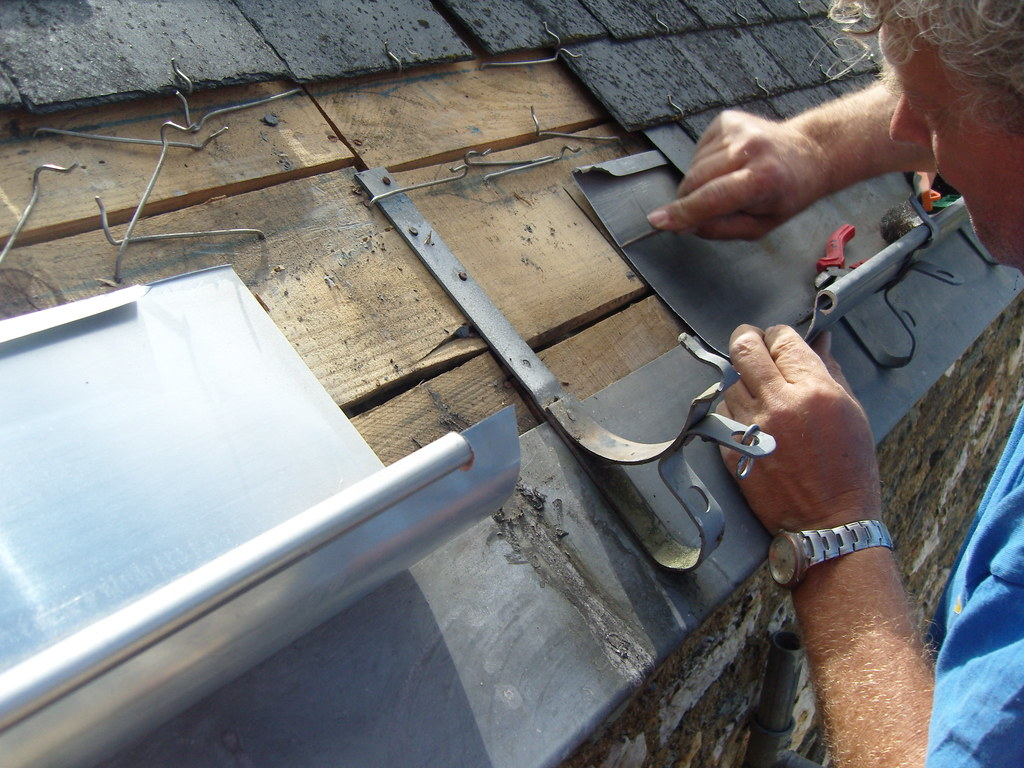 Preparing A New Section Of Zinc Guttering The Old
