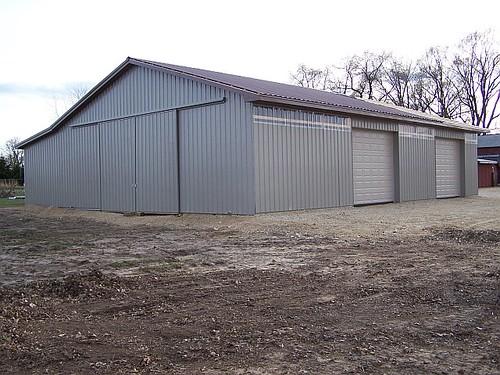 Diy Metal Barns : Diy pole barn all of the metal has been added