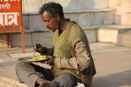 Man Eating Indian Food