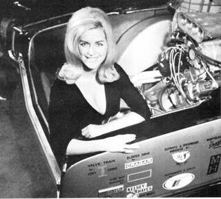 "Linda Vaughn in the back of Oldsmobile ""4-4-2 Much"" 