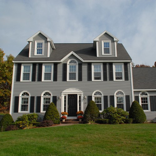 Beautiful colonial style home with newpro siding windows for Colonial style homes pictures