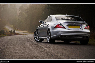 Mercedes Benz CLS 63 AMG Low Rear Quarter Shot Looking Down The Twisty Road | by NWVT.co.uk