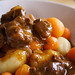 Beef stew with small potato dumplings and carrots