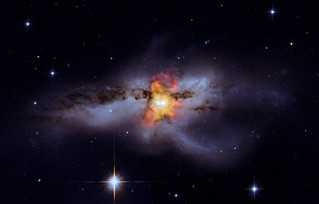 Black Holes Go Mano A Mano: A galaxy about 330 million light years from Earth. | by Smithsonian Institution
