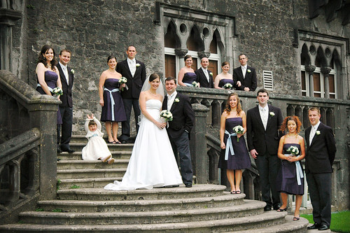 Large Wedding Party On Steps Of Kilkenny Castle In Ireland