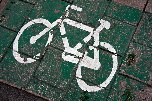 White bike sign on green tiled sidewalk | by Horia Varlan