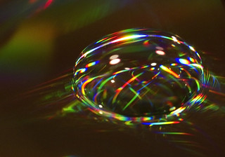 Jewel (Macro - water drop on the back of a DVD disk...) | by Rick Leche