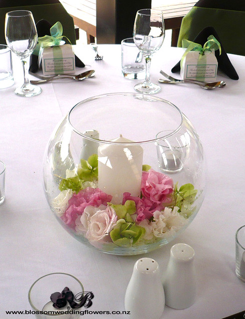 Table flowers bowls candles wedding centerpiece