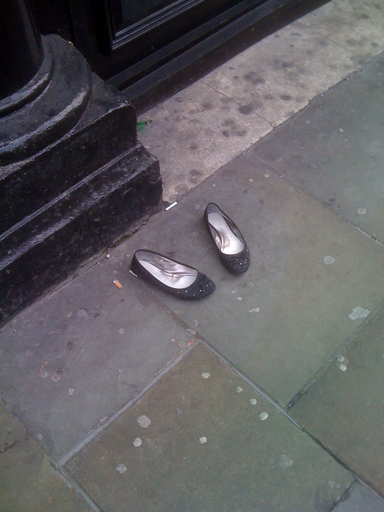 Abandoned shoes at smoking spot, Pit and Pendulum | David ...: http://www.flickr.com/photos/rubberdreamfeet/4511008172/