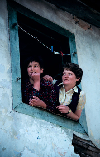 Women look out of a window | by World Bank Photo Collection