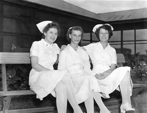 World War II nurses holding hands | by gbaku